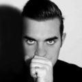 Tony Lewis as Robbie Williams